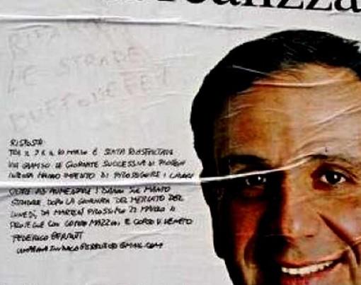 Manifesti interattivi: Berruti risponde agli insulti sullo stesso manifesto dov'erano stati scritti